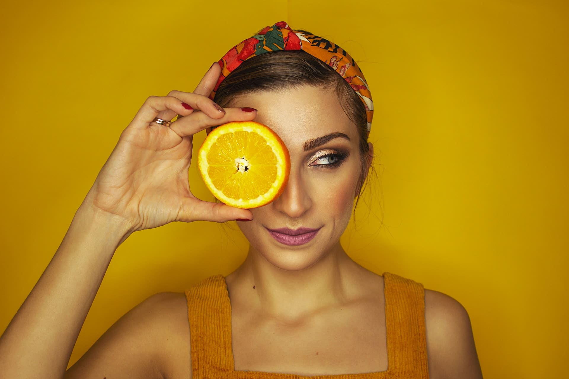 Model Holding Slice of Orange