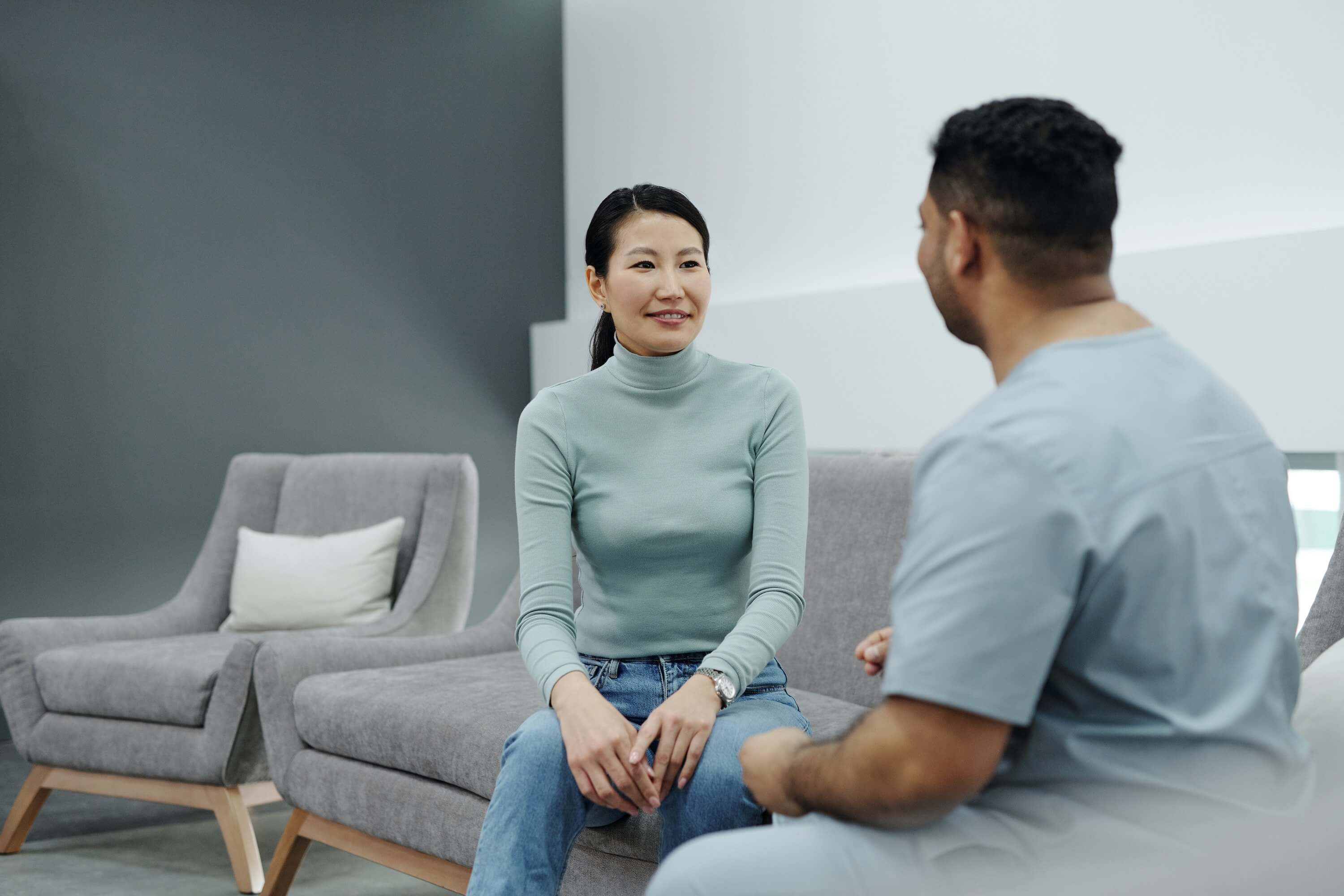 woman-and-a-man-sitting-on- a-couch-in-a-clinic